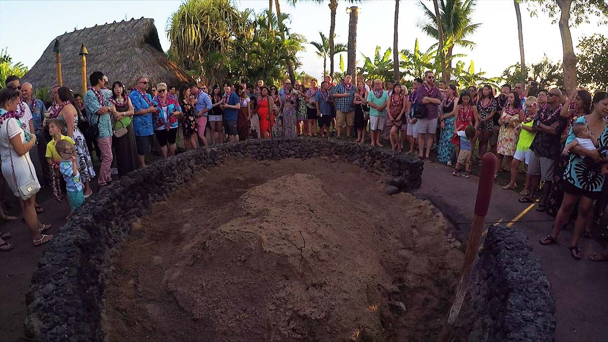 Gathering around the Imu waiting for the ceremony Top things to do in Hawaii