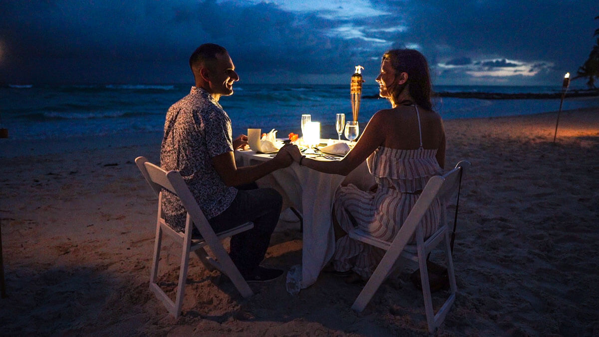 Vacation Couple having a Romantic Beach Dinner at Sandals Royal Barbados