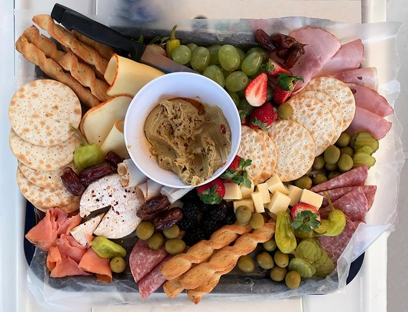 Yacht Week BVI Hostess Charcuterie Tray on the Yacht with Vacation Couple