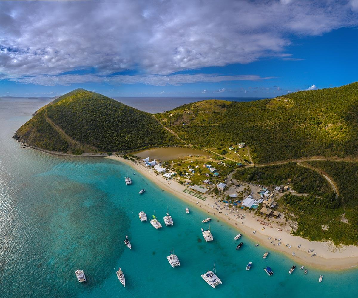 soggy dollar bar aerial view jost van dyke british virgin islands yacht week bvi with vacation couple