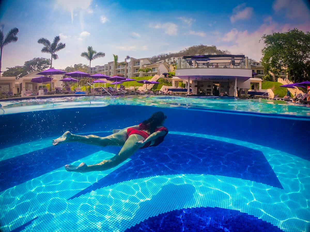 planet-hollywood-beach-reasort-costa-rica-main-pool-gopro-dome-over-under-vacation-couple