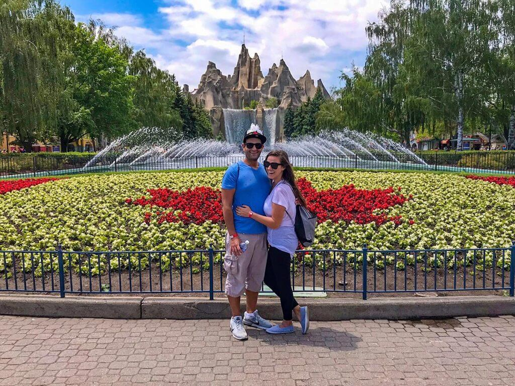 vacation couple in front of the grand garden and mountain at canadas wonderland
