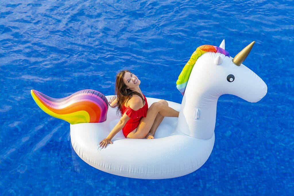 Kristin of vacation Couple in unicorn float is one of the best gifts for someone going travelling